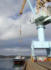 Big crane at Esquimalt lifts the Coastal Messenger.