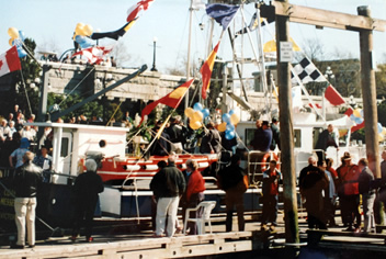 Commissioning service of the new Coastal Messenger in the Victoria Inner Harbour, all decorated with coloured flags.