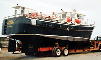 Sideview of Coastal Messenger on trailer.